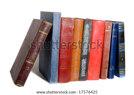 collection of old books on white ground