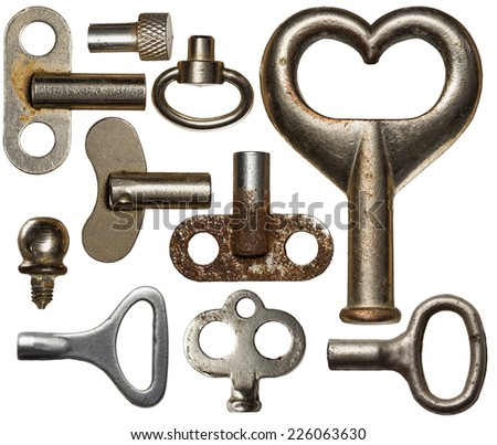 Collection of old clockwork keys, isolated. - stock photo
