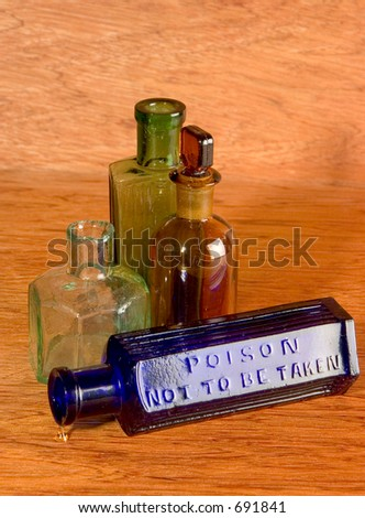 Collection of old medicine bottles on a wooden background. - stock photo