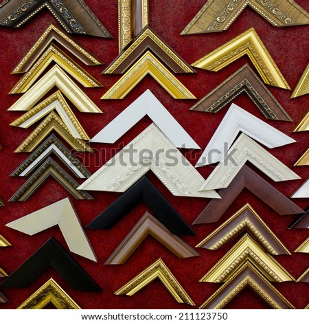 Collection of old photo corners, frames and edges isolated on red background - stock photo