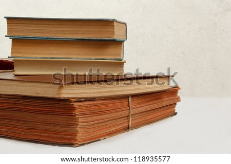 collection of old worn books on white