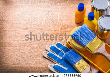 Collection of paint tools on wooden board maintenance concept  - stock photo