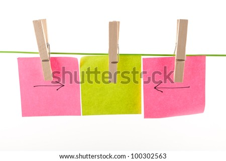 Collection of paper notes and clothes pegs on white background