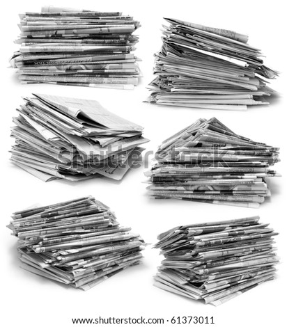 Collection of piles of newspapers on white background