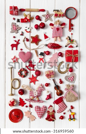 Collection of red and white checkered christmas decoration on wooden background. - stock photo