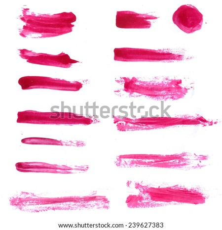 Collection of red cosmetic lipstick and nail polish isolated swatches.