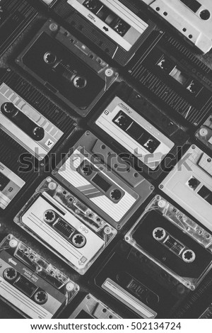 Collection of retro cassette tapes places in diagonal angle. Vintage style and filtered process. Black and White Tone.