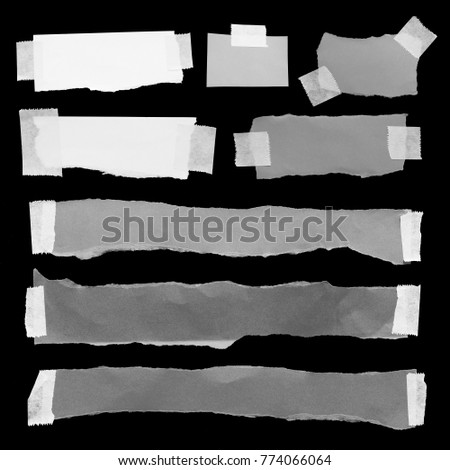 collection of ripped note paper with adhesive tape on a black background