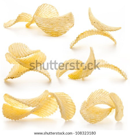 Collection of rippled potato chips isolated on white background - stock photo