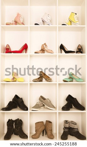 Collection of shoes on shelves - stock photo