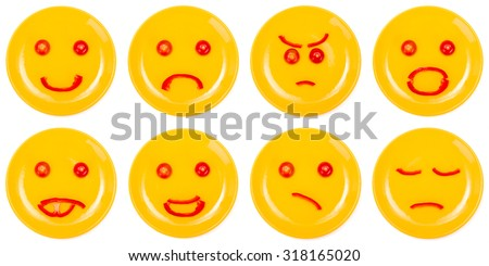 Collection of smiley faces made on yellow plate with tomato and pepper slice