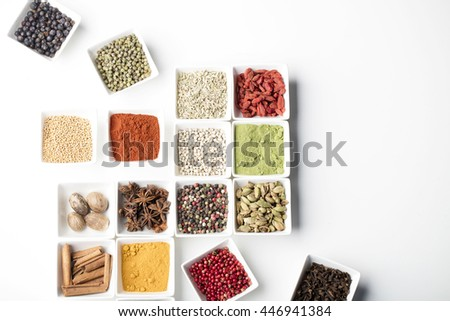 collection of spices  in ceramic bowls