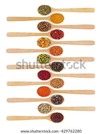 Collection of spices in wooden spoons, isolated on white - stock photo