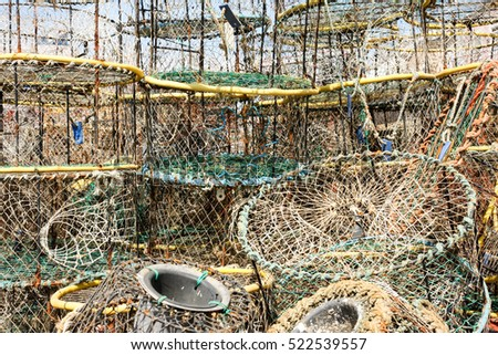 Collection of stacked up crab baskets and nets