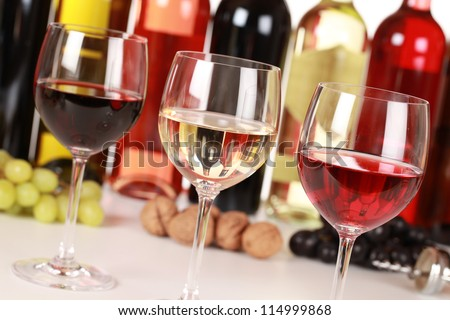 Collection of three different wines in glasses with selective focus.