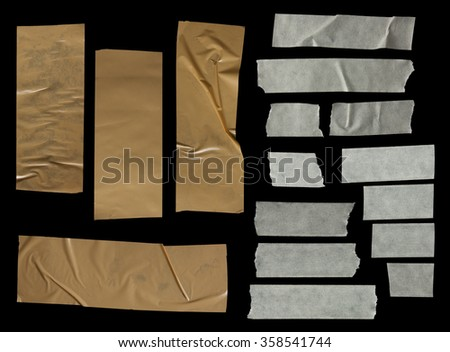 collection of various adhesive tape pieces on black background. - stock photo