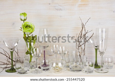Collection of various glassware on wooden background - stock photo