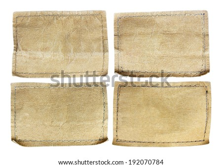 collection of various jeans labels on white background - stock photo