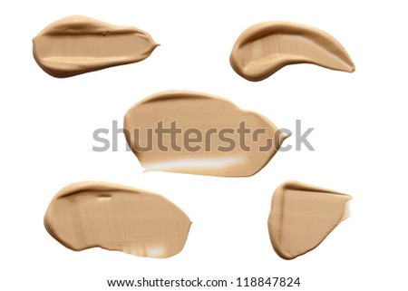 collection of various make up liquid powder strokes on white - stock photo