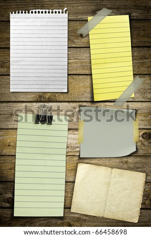 Collection of various note papers on wooden background - stock photo