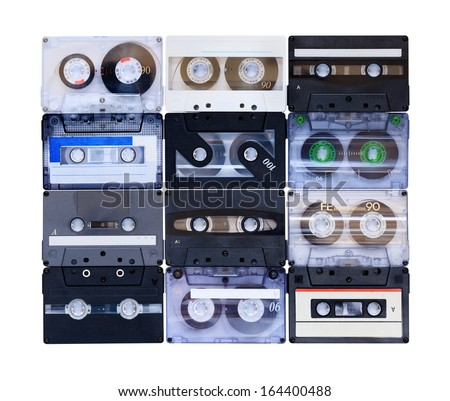 Collection of various vintage audio tapes on white background