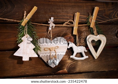collection of various vintage wooden christmas decorations hanging on twine  - stock photo