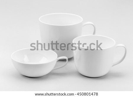 Collection of various white coffee or tea cups - stock photo