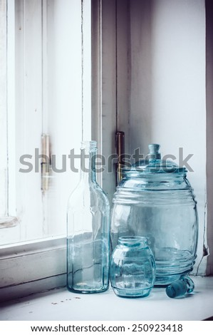 Collection of vintage blue-green glass kitchen utensils, retro home decor. - stock photo