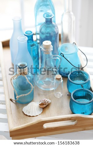 Collection of vintage bottles on a wooden tray - stock photo