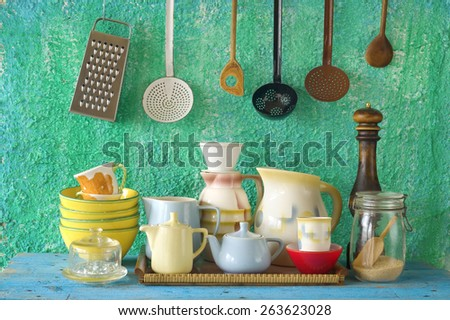 collection of vintage kitchenware, green wall  background  - stock photo