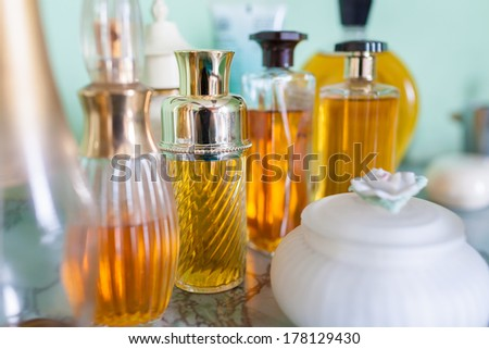 Collection of vintage perfume bottles - stock photo