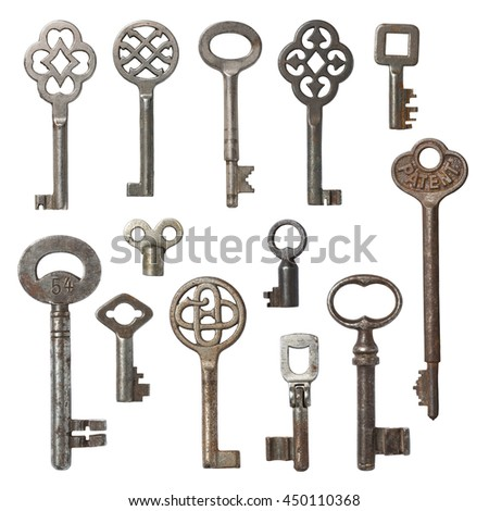 collection of vintage skeleton keys isolated on white - stock photo