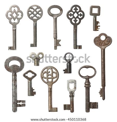 collection of vintage skeleton keys isolated on white - stock photo