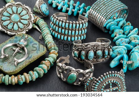 Collection of Vintage Turquoise and Silver Jewelry. - stock photo