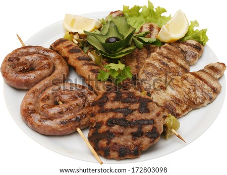 Collection of warm meat dishes includes meat balls, steak filled and sausages from lamb, pork, chicken and beef dishes. Grilled on a barbecue grill - stock photo