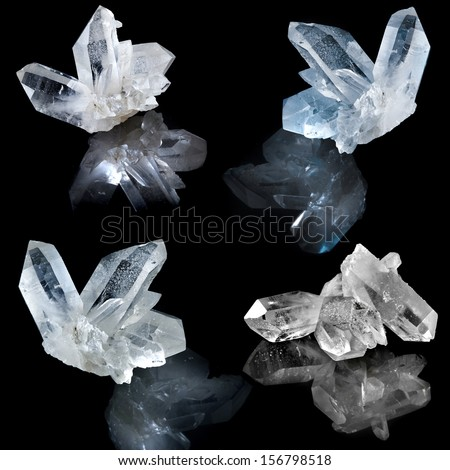 Collection of white natural rock crystal with reflection on black surface background  - stock photo