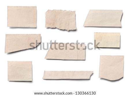 collection of  white ripped pieces of news paper on on white background. each one is shot separately
