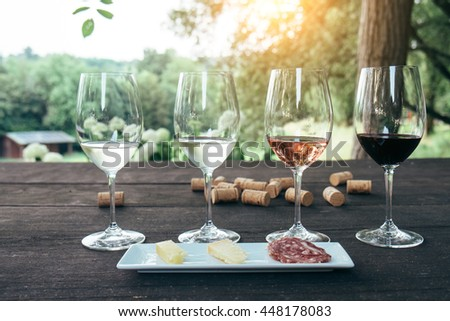 Collection of wine glasses on wooden table