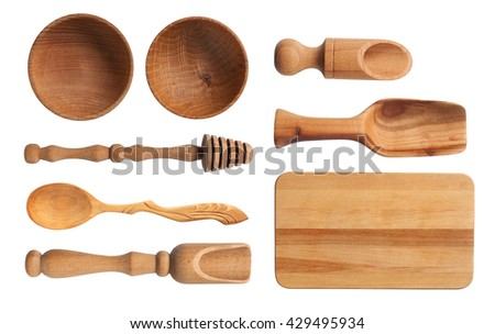 Collection of wooden kitchen utensils isolated on white background. - stock photo