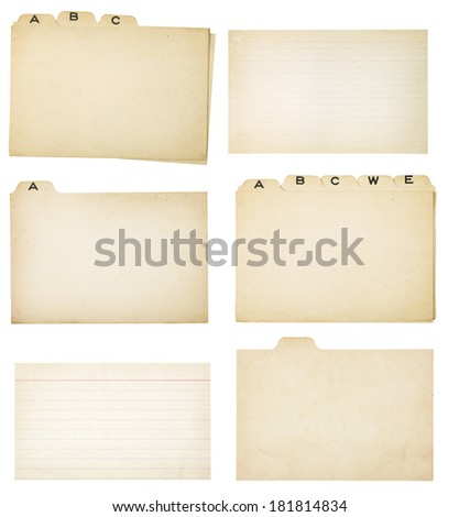 Collection of yellowing tabbed index cards and two faded, lined index cards without tabs.  Each card or group is isolated on white with clipping path. - stock photo