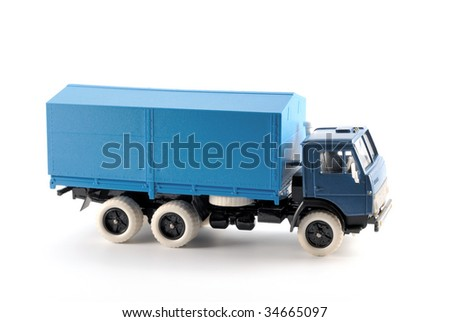 Collection scale model of the truck on a light background - stock photo