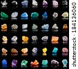 Collection set of semi-precious gemstones stones and minerals with names on black  background  - stock photo