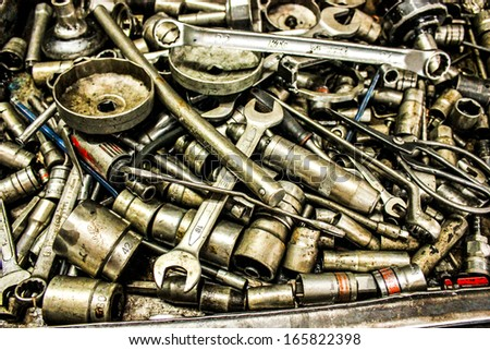 collection spanner and wrench repair tool spare parts used in car auto service station - stock photo