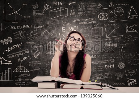 College female student is learning in the classroom - stock photo