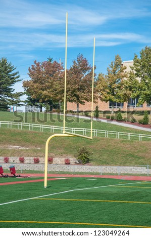 College football goal post under bright blue sky - stock photo