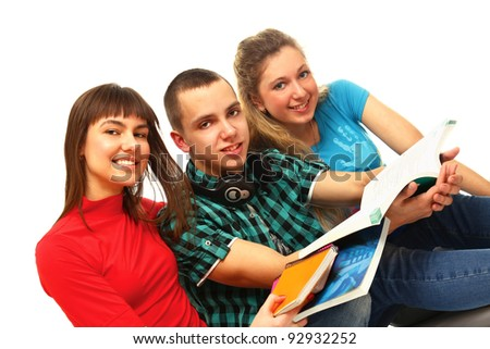 College friends with book sitting on the floor isolated on white background