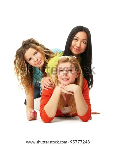 College girls lying on the floor, isolated on white background - stock photo