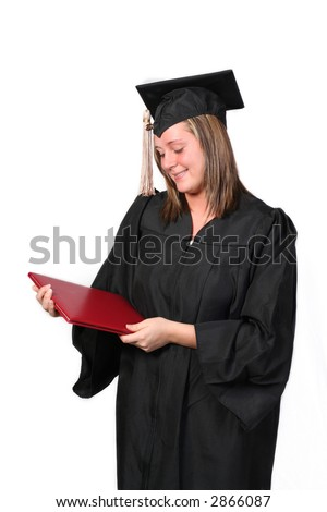 College graduate staring proudly at her diploma