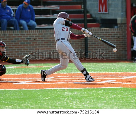 COLLEGE PARK, MD - APRIL 2: Florida State University catcher Rafael Lopez swings at a pitch and tips it off the end of the bat during a game against Maryland April 2, 2011 in College Park, MD. - stock photo