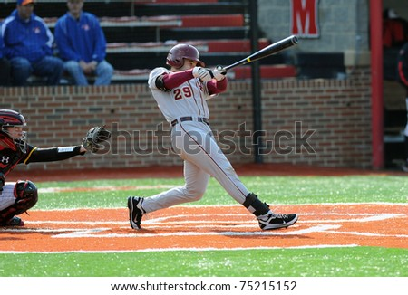 COLLEGE PARK, MD - APRIL 2: Florida State University catcher Rafael Lopez swings at a pitch during a game against conference foe Maryland April 2, 2011 in College Park, MD. - stock photo